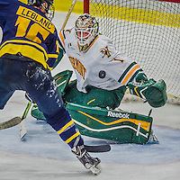 21 February 2015:  University of Vermont Catamount Goaltender Mike Santaguida, a Sophomore from Mississauga, Ontario, makes a second period save against the Merrimack College Warriors at Gutterson Fieldhouse in Burlington, Vermont. The teams played to a scoreless tie as the Cats wrapped up their Hockey East regular home season. Mandatory Credit: Ed Wolfstein Photo *** RAW (NEF) Image File Available ***
