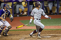 Texas A&M Aggies outfielder Nick Banks (4) follows through on his swing during a Southeastern Conference baseball game against the LSU Tigers on April 24, 2015 at Alex Box Stadium in Baton Rouge, Louisiana. LSU defeated Texas A&M 9-6. (Andrew Woolley/Four Seam Images)