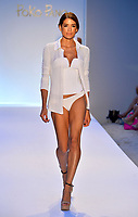 MIAMI BEACH, FL - JULY 19:  A model walks the runway at the Poko Pano show during Mercedes-Benz Fashion Week Swim 2014 at the Raleigh on July 19, 2013 in Miami Beach, Florida <br />
