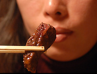 A customer eats whale steak at the Kujiraya (Whale) Restaurant in Shibuya, Tokyo Japan. The Restaurant is one of a few that serve exclusively whale meat in Tokyo..20 Nov 2007