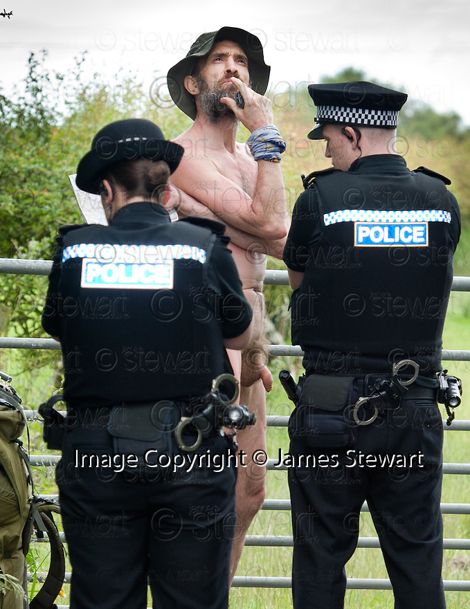 Naked rambler Stephen Gough talks to police officers from Fife Constabulary prior to being arrested outside the village of Townhill, north of Dunfermline.