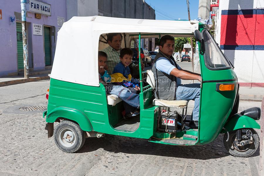 Tlacolula, Oaxaca; Mexico.  Three-wheeled Moto-taxi and Passengers.