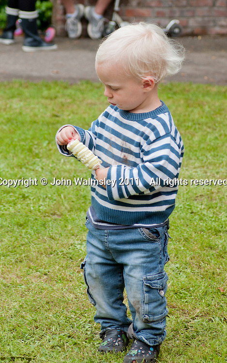 Enjoying a small ice cream at the reunion for Summerhill School's 90th birthday celebrations.