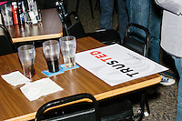 A campaign sign lays on a table next to unfinished beverages after Texas senator and Republican presidential candidate Ted Cruz spoke at The Village Trestle restaurant in Goffstown, New Hampshire, on Wed., Feb. 3, 2016.