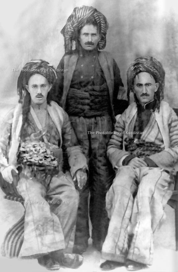 Iraq 1944  .Three Kurds in their traditionnal costumes posing: left, Fatah Agha, in the middle, Haji Saleh, right, ?  .Irak 1944 .Trois kurdes posant en costume traditionnel, a gauche,Fatah Agha, au milieu, Haji Saleh, a droite, ?