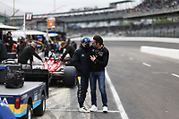 28th May 2021; Indianapolis, Indiana, USA;  NTT Indy Car Series car driver Tony Kanaan talks with 3 time Indy 500 winner Dario Franchitti as he prepares for the 105th running of the Indianapolis 500