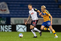 Bolton Wanderers' Antoni Sarcevic competing with Mansfield Town's George Lapslie (right) <br /> <br /> Photographer Andrew Kearns/CameraSport<br /> <br /> The EFL Sky Bet League Two - Bolton Wanderers v Mansfield Town - Tuesday 3rd November 2020 - University of Bolton Stadium - Bolton<br /> <br /> World Copyright © 2020 CameraSport. All rights reserved. 43 Linden Ave. Countesthorpe. Leicester. England. LE8 5PG - Tel: +44 (0) 116 277 4147 - admin@camerasport.com - www.camerasport.com