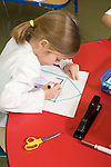 Education Elementary Kindergarten 5 or 6 year old girl art activty drawing
