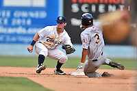 Asheville Tourists shortstop Brendon Rodgers (1) moves into second to field the throw as Gosuke Katoh (3) slides in safely during game one of a double header against the Charleston RiverDogs at McCormick Field on July 8, 2016 in Asheville, North Carolina. The RiverDogs defeated the Tourists 10-4 in game one. (Tony Farlow/Four Seam Images)