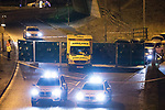 © Joel Goodman - 07973 332324 . 03/01/2017. Huddersfield, UK. Police erect a screen around the scene of a bullet riddled white Audi car at the slip road at Junction 24 of the M62 motorway in Huddersfield . West Yorkshire police have announced a man has died following the discharge of a police firearm , during what they describe as a pre-planned operation , yesterday evening (2nd January 2017) . Photo credit : Joel Goodman