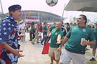 United States and Mexican national team supporters kick a soccer ball together before the World Cup second round match between the United States and Mexico at Jeonju World Cup stadium on June 17th, 2002.  The United States defeated  Mexico 2-0 to advance to the World Cup Quarterfinals.
