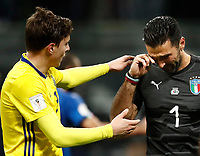 Soccer Football - 2018 World Cup Qualifications - Europe - Italy vs Sweden - San Siro, Milan, Italy - November 13, 2017 <br /> Sweden Victor Lindelof (l) greets Italy's Captain and goalkeeper Gianluigi Buffon (r) at the end of the FIFA World Cup 2018 qualification football match between Italy and Sweden at the San Siro stadium in Milan, on November 13, 2017. <br /> Sweden reaches the Fifa World Cup 2018.<br /> Italy failed to reach the World Cup for the first time since 1958.<br /> UPDATE IMAGES PRESS/Isabella Bonotto