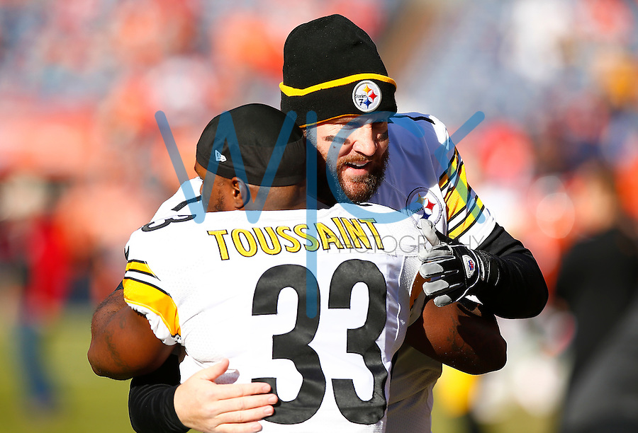 Ben Roethlisberger #7 and Fitzgerald Toussaint #33 of the Pittsburgh Steelers in action against the Denver Broncos during the AFC Divisional Round Playoff game at Sports Authority Field at Mile High on January 17, 2016 in Denver, Colorado. (Photo by Jared Wickerham/DKPittsburghSports)