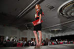 A model walks the runway at the Sisters Network's 2013 Pink Angel Celebration Luncheon & Style Show Sunday Oct. 13,2013.(Dave Rossman photo)