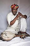 45-year-old Manganiyar artist and Kamancha player, Ghewar Khan poses for a portrait inside his house in Hamira village of Jaiselmer district in Rajasthan, India. Photo: Sanjit Das/Panos