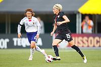 14 MAY 2011: USA Women's National Team midfielder Megan Rapinoe (15) dribbles the ball by Japan National team Mizuho Sakaguchi during the International Friendly soccer match between Japan WNT vs USA WNT at Crew Stadium in Columbus, Ohio.