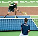 Bob Bryan volleys back a ball to Luka Gregorc at the Freedoms vs. Explorers WTT match in Villanova, PA on July 16, 2012