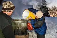 Volunteers boiling water for mushers in the early morning @ Takotna Chkpt 2006 Iditarod Alaska Winter