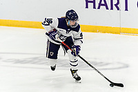 WORCESTER, MA - JANUARY 16: Emma Lange #16 of Holy Cross brings the puck forward during a game between Boston College and Holy Cross at Hart Center Rink on January 16, 2021 in Worcester, Massachusetts.