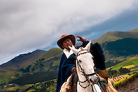 """A young boy rides a white horse during the Inti Raymi festival in Pichincha province, Ecuador, 26 June 2010. Inti Raymi, """"Festival of the Sun"""" in Quechua language, is an ancient spiritual ceremony held in the Indian regions of the Andes, mainly in Ecuador and Peru. The lively celebration, set by the winter solstice, goes on for various days. The highland Indians, wearing beautiful costumes, dance, drink and sing with no rest. Colorful processions in honor of the God Inti (Sun) pass through the mountain villages giving thanks for the harvest and expressing their deep relation to the Mother Earth (Pachamama)."""
