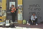 Carlos Gardel  look alike San Telmo Buenos Aires Street market scene man busking Argentina South America. 2000s 2002