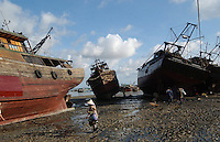Workers restore the fishing ships near the habour in Beihai, China..18-JUL-03