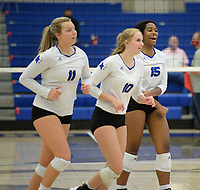 Rogers' Phoenix Bailey (15), Lakyn Hawthorne (10) and Gracie Carr (11) celebrate a point Tuesday, Oct. 13, 2020, during play against Bentonville in King Arena in Rogers. Visit nwaonline.com/201014Daily/ for today's photo gallery. <br /> (NWA Democrat-Gazette/Andy Shupe)