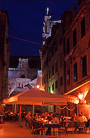Croatia. Dubrovnik Old City. People eating at the  restaurants in Gundulic's Square (Gunduliceva Polijana) at night.