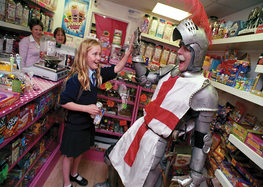 """Saint George of England greets a customer at Auntie Pamís sweet shop, Bury St Edmunds. 2014<br /> <br /> """"St George will liberate car parking in Bury St Edmunds."""""""