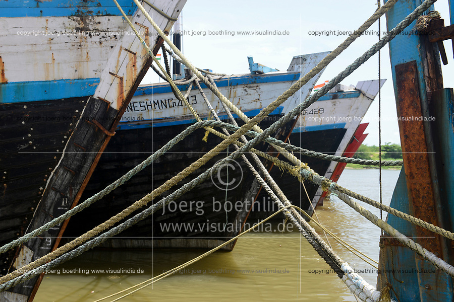INDIA, Karnataka, Mangaluru, former name Mangalore, wooden cargo boats in old port tied together with ropes at quai