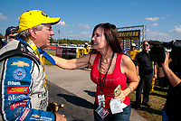 Sep 2, 2019; Clermont, IN, USA; NHRA funny car driver John Force celebrates with wife Laurie Force after winning the US Nationals at Lucas Oil Raceway. Mandatory Credit: Mark J. Rebilas-USA TODAY Sports