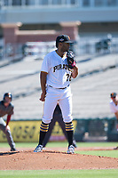 Surprise Saguaros starting pitcher Dario Agrazal (76), of the Pittsburgh Pirates organization, looks in for the sign during an Arizona Fall League game against the Salt River Rafters on October 9, 2018 at Surprise Stadium in Surprise, Arizona. Salt River defeated Surprise 10-8. (Zachary Lucy/Four Seam Images)