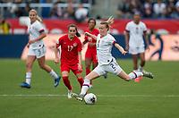 Emily Sonnett #2  of the United States passes off the ball