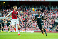 ( L-R ) Per Mertesacker of Arsenal and Tammy Abraham of Swansea City chase the ballduring the Premier League match between Arsenal and Swansea City at Emirates stadium, London, England, UK. Saturday 28 October 2017