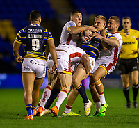 13th November 2020; The Halliwell Jones Stadium, Warrington, Cheshire, England; Betfred Rugby League Playoffs, Catalan Dragons versus Leeds Rhinos; Mikolaj Oledzki of Leeds Rhinos is tackled