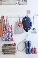 A variety of clothing and accessories greets the visitor to this cheery Dutch apartment