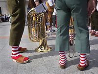 """Switzerland. Ticino. Lugano. MASI LAC.  LAC Lugano Arte e Cultura. Federal Choir Festival in Costume. Musicians wearing colorful socks and clogs. The tuba is the largest and lowest-pitched musical instrument in the brass family. Like all brass instruments, sound is produced by vibrating or """"buzzing"""" the lips into a large cupped mouthpiece.  LAC Lugano Arte e Cultura is a new cultural centre dedicated to the visual arts, music and the performing arts. 12.06.2016 © 2016 Didier Ruef"""