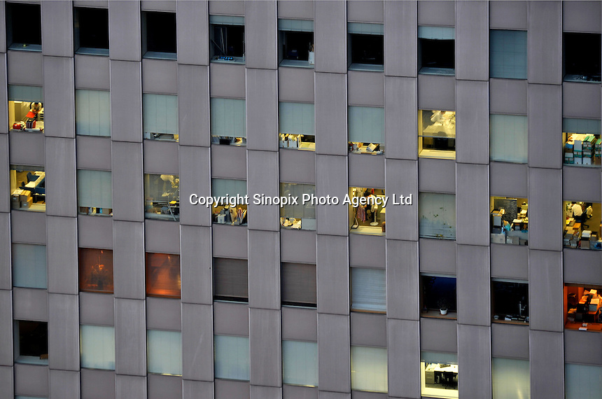 An office building in the Shinjuku district of downtown Tokyo, Japan. Karoshi, or death from overwork, is still common in Japan where the workers have much longer working hours than any other industrialized country..11 Jun 2009