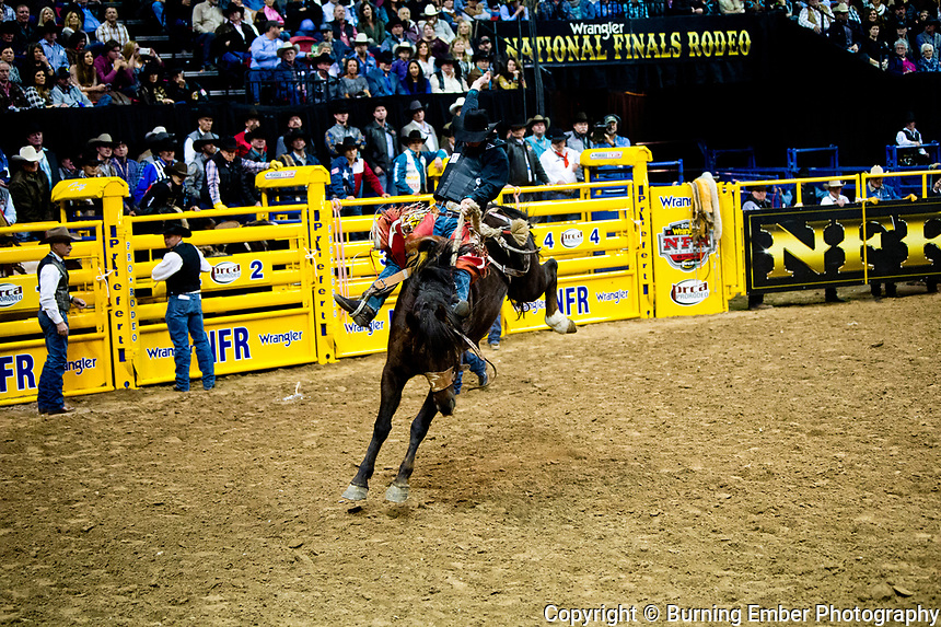 Layton Green on Miss Chestnut of Powder River Rodeo in the Saddle Bronc event during the Wrangler National Finals Rodeo 1st round December 6th, 2017.  Photo by Josh Homer/Burning Ember Photography.  Photo credit must be given on all uses.