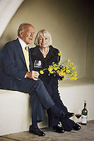 USA. California state. Napa valley. A picture of Margrit Biever Mondavi and her husband Robert Mondavi at the entrance of Robert Mondavi Winery, To Kalon Vineyard. <br /> Margrit Biever Mondavi (born 1926 in Switzerland) is Vice President of Art and Culture at Robert Mondavi Winery which she joined in 1967. Under her direction, Robert Mondavi Winery developed original cultural and culinary arts programs. In 1980, she married Robert Mondavi and worked with him in many of his philanthropic activities. Robert Gerald Mondavi (June 18, 1913 – May 16, 2008) was a leading California vineyard operator whose technical improvements and marketing strategies brought worldwide recognition for the wines of the Napa Valley in California. 16.12.2014 © 2014 Didier Ruef