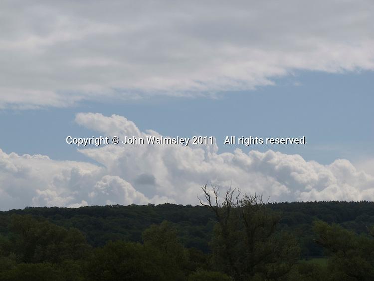 Cumulus clouds above the Lake District, Cumbria, UK.