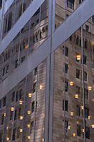 AVAILABLE FROM JEFF FOR EDITORIAL LICENSING.<br /> <br /> Office Building Windows with Reflection of the Facade of the Federal Reserve Bank of New York, Lower Broadway, Lower Manhattan's Financial District, New York City, New York State, USA