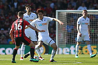Ki Sung-yueng of Swansea City is challenged by Lewis Cook of Bournemouth during the Premier League match between AFC Bournemouth and Swansea City at Vitality Stadium in Bournemouth, England, UK. Saturday 05 May 2018