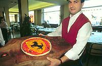 """- pizza """"Ferrari"""" prepared in a restaurant of Maranello, center of the Ferrari plant....- pizza """"Ferrari"""" preparata in un locale di Maranello, sede dello stabilimento Ferrari"""