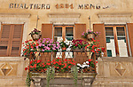 Balcony covered in flowers in the small town of Castasegna, a Swiss town right on the border with Italy in the Bregaglia Valley