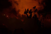 The Maidan independence monument under dense clouds of smoke coming from the burning barricades.  Kiev, Ukraine