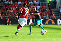 Famara Diédhiou of Bristol City is tackled by Matt Grimes of Swansea City during the Sky Bet Championship match between Bristol City and Swansea City at Ashton Gate in Bristol, England, UK. Saturday 21 September 2019