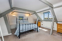 BNPS.co.uk (01202 558833)<br /> Pic: Savills/BNPS<br /> <br /> Pictured: A bedroom.<br /> <br /> A former tidal mill next to an impressive viaduct that looks like the perfect backdrop for a children's book is on the market for £3.5m.<br /> <br /> The Old Mill is over 600 years old and would be an ideal home for Swallows and Amazons or The Railway Children-inspired adventures.<br /> <br /> The impressive Grade II listed six-bedroom house has its own private harbour and panoramic views of the much-photographed Forder Railway Viaduct.<br /> <br /> It is only the second time the property in Cornwall has been on the market since 1886 and agents Savills say it is a once in a lifetime opportunity.