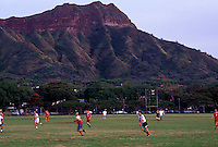 Boys playing soccer in the shadow of Diamond Head