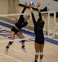 Lakyn Hawthorne (10) spikes ball against Ana Bastos (12) of Bentonville West at Rogers High School, Rogers, AR, on Thursday, September 9, 2021 / Special to NWADG David Beach